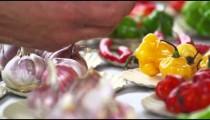 Close-up shot hand choosing bulbs of garlic and different peppers in Rio de Janeiro, Brazil