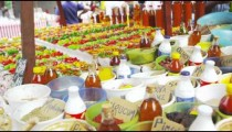 Panning shot of different spices and pepper varieties in a market in Rio de Janeiro, Brazil