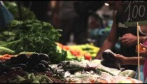 Slow motion shot of people buying produce in a market in Rio de Janeiro, Brazil