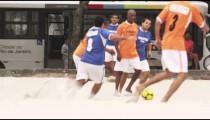 RIO DE JANEIRO, BRAZIL - JUNE 23: Slow motion pan - playing soccer on June 23, 2013 in Rio, Brazil