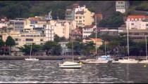 Wide panning shot of town along the coastline in Rio de Janeiro, Brazil