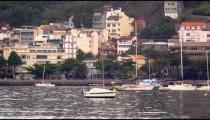 Wide panning shot of town along the coastline in Rio de Janeiro, Brazil