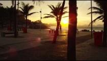 Slow camera pan over a picnic area at Ipanema Beach in Rio de Janeiro at sunset