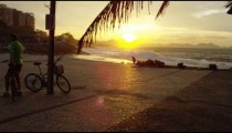 Slow camera movement over an area at Ipanema Beach in Rio de Janeiro at sunset.