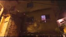 Lens flare panning shot of a house at a favela in Rio de Janeiro, Brazil