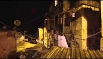Lens flare pan of apartments at a favela in Rio de Janeiro, Brazil