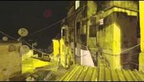 Lens flare pan of houses at a favela in Rio de Janeiro, Brazil