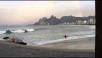 Pan shot of the beach bellow the rest area at Ipanema Beach in Rio de Janeiro.