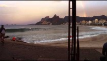 Camera pans to a rainbow in the distance at Ipanema Beach in Rio de Janeiro