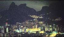 Slow pan of downtown Rio de Janeiro at night in Brazil