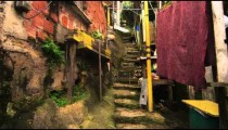 Tracking shot of shanties along the stairs in a favela in Rio de Janeiro, Brazil