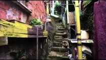 Tracking shot of crowded shanties along the stairs in a favela in Rio de Janeiro, Brazil