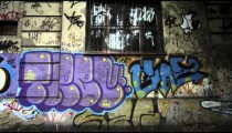 Slow motion dolly shot of various wall paintings along the street in Rio de Janeiro, Brazil