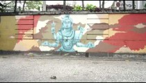 Slow motion dolly shot of different paintings on walls along a street in Rio de Janeiro, Brazil