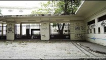 Slow motion tracking shot of graffiti art on perimeter wall of a building in Rio de Janeiro, Brazil