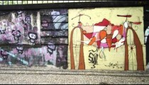 Slow motion dolly shot of graffiti art on perimeter wall of a building in Rio de Janeiro, Brazil