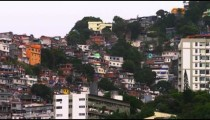 Panning shot of houses at a favela along the mountainside in Rio de Janeiro, Brazil