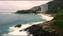 Slow motion tilting shot of Sugarloaf Mountain and the coastline at Rio de Janeiro, Brazil