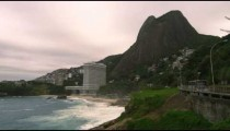 Slow motion panning shot of Sugarloaf Mountain and the coastline at Rio de Janeiro, Brazil