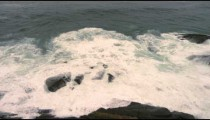 Slow motion shot of crashing waves at the coastline in Rio de Janeiro, Brazil