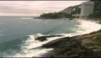 Slow motion of waves crashing on rocks at the beach in Rio de Janeiro, Brazil