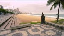 Slow tracking shot of a bronze statue near Ipanema Beach in rio de Janeiro, Brazil