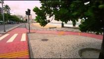 Slow dolly shot of pink sidewalk at Copacabana Beach in Rio de Janeiro, Brazil
