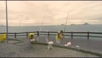 RIO DE JANEIRO, BRAZIL - JUNE 23: Slow dolly shot of men fishing on June 23, 2013 in Rio, Brazil