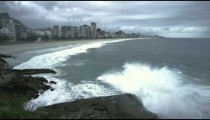 Slow motion shot of big waves crashing onto the rocks at the beach in Rio de Janeiro, Brazil
