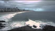 Slow pan of Rio de Janeiro skyline along the beach in Rio de Janeiro, Brazil