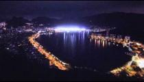 Panning shot of lagoon at night in Rio de Janeiro, Brazil