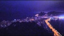 Pan of cityscape of Rio de Janeiro, Brazil at night