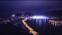 Panning shot of cityscape of Rio de Janeiro, Brazil at night