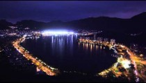 Panning shot of metropolis and lagoon in Rio de Janeiro, Brazil