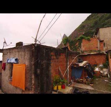 Tilting dolly shot of homes in a favela in Rio de Janeiro, Brazil