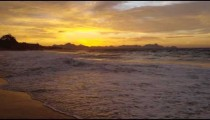 Slow motion, tracking shot of the tide coming in on Devil's beach