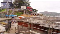 Slow tracking shot of favela community before the start of a soccer game