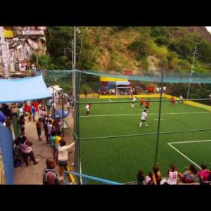 RIO DE JANEIRO, BRAZIL - JUNE 23: Slow tracking shot down stairs of a community soccer game