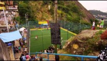 RIO DE JANEIRO, BRAZIL - JUNE 23: Slow tracking shot down stairs with a great view of a soccer game