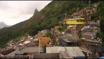 RIO DE JANEIRO, BRAZIL - JUNE 23: Slow panning shot overlooking favela of Rio showing a soccer game