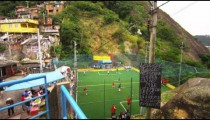 RIO DE JANEIRO, BRAZIL - JUNE 23: Tracking shot of soccer game to scenic view of a favela