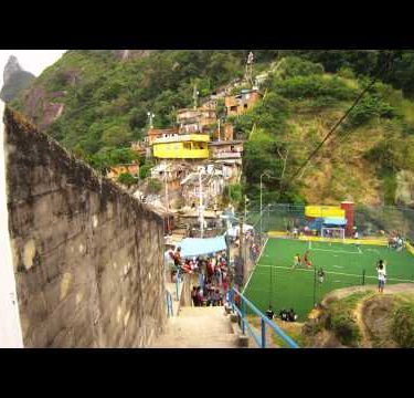RIO DE JANEIRO, BRAZIL - JUNE 23: Slow tracking down a flight of stairs to soccer game in a favela
