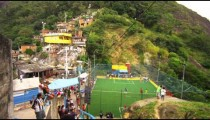 RIO DE JANEIRO, BRAZIL - JUNE 23: Slow tracking down a flight of stairs of soccer game in a favela