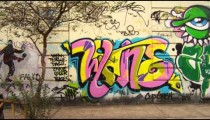 Tracking shot of a wall covered in graffiti in Rio de Janeiro, Brazil