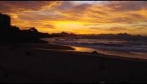 Tracking shot over Devil's beach (Praia do Diabo) at dusk - different frame rate