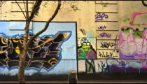RIO DE JANEIRO, BRAZIL - JUNE 23: Slow tracking down a street with wall full of street art