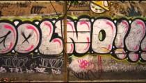 Slow motion dolly shot of graffiti on a wall along a street in Rio de Janeiro, Brazil