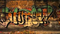 Slow motion tracking shot of graffiti on a wall along a street in Rio de Janeiro, Brazil