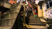 Slow motion panning/tracking shot inside favela neighborhood in Rio de Janeiro, Brazil
