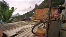 Slow tracking shot of messy area in a favela in Rio de Janeiro, Brazil